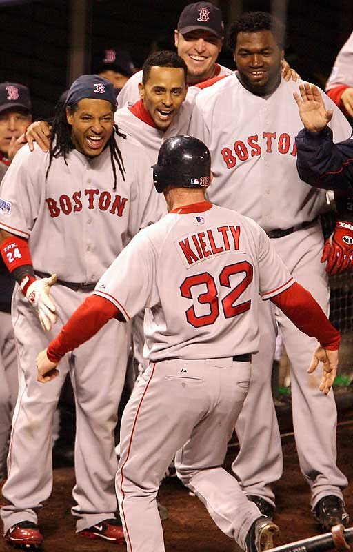 Bobby Kielty celebrates with his teammates after sending a solo bomb into the left-field bleachers.