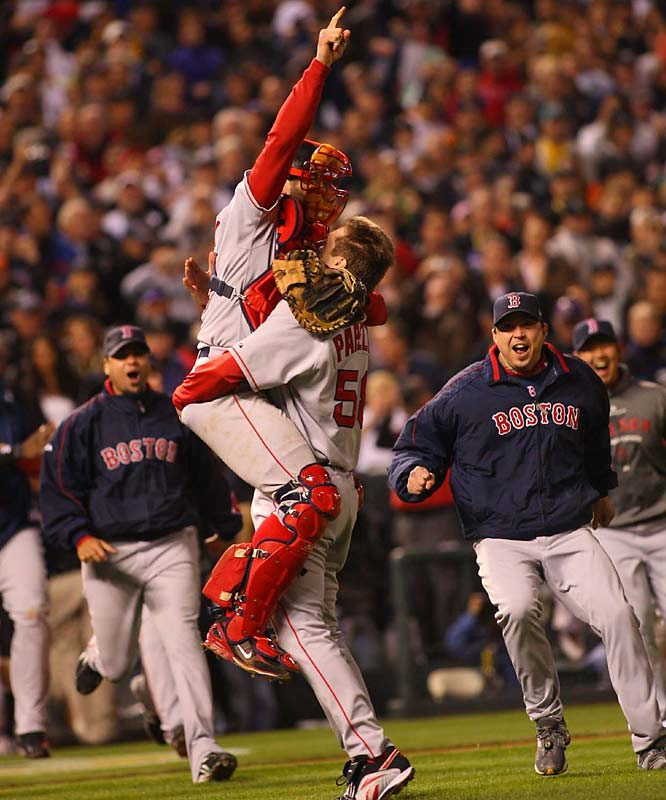 Jonathan Papelbon holds up Jason Varitek with all of his energy after the final out was recorded.