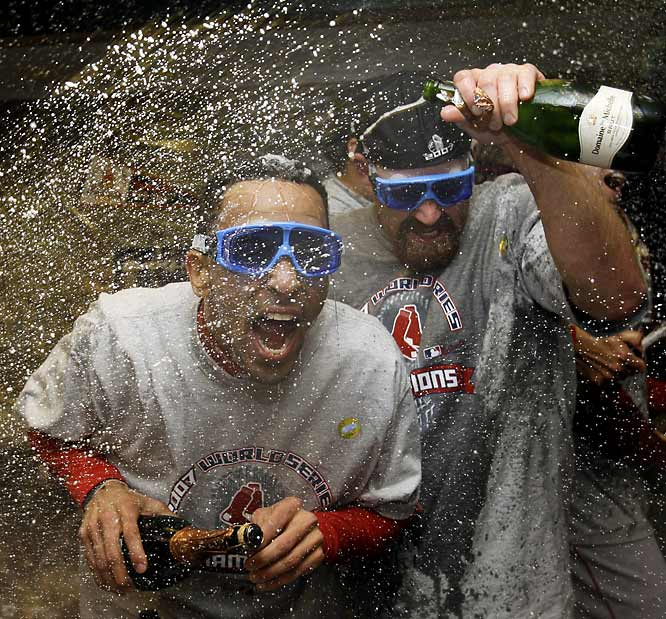 Kevin Youkilis and Julio Lugo have gotten used to the champagne throughout the postseason.