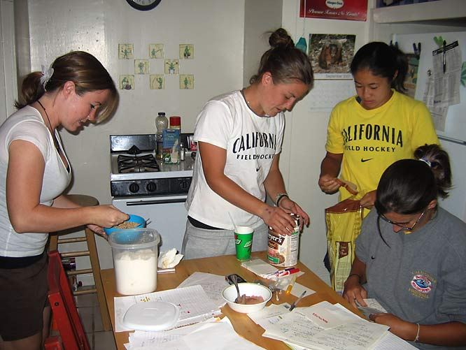 In their roomy kitchen, the girls prepare a hearty breakfast of cereal and ice cream.