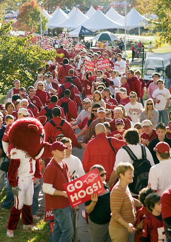 Arkansas fans line the sidewalks to greet the team as it walks to the stadium before Saturday's game against  South Carolina.