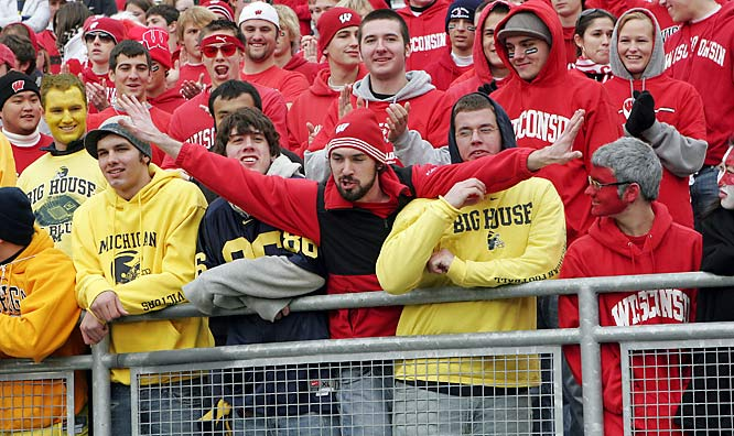 A Wisconsin student is not pleased that these Michigan fans got front-row seats at Camp Randall Stadium.