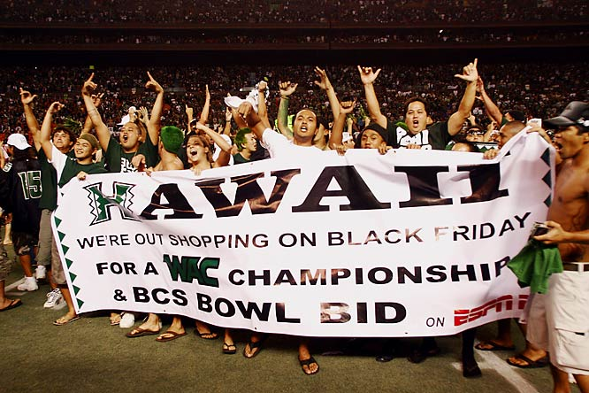 A group of Hawaii fans bust out a banner to celebrate the Rainbows' likely BCS bid.