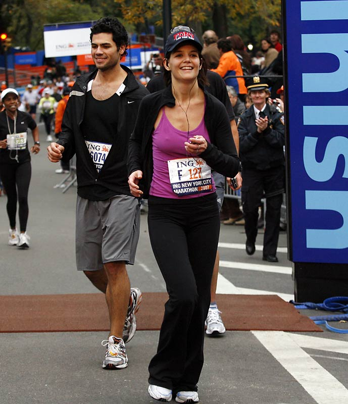 That guy looked happy to be running behind Katie Holmes at Sunday's New York City Marathon.