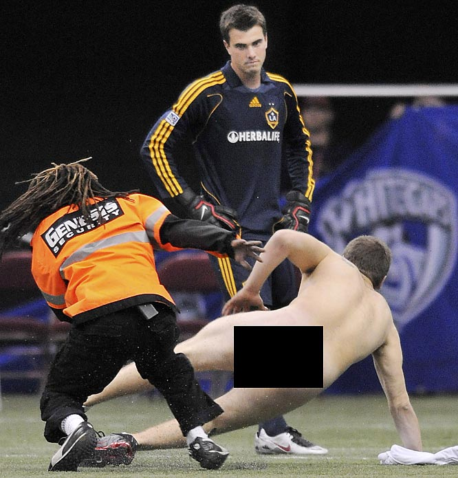 Galaxy goalie Joe Cannon seems to be focused on something as a streaker invaded L.A.'s game against Vancouver on Wednesday night.