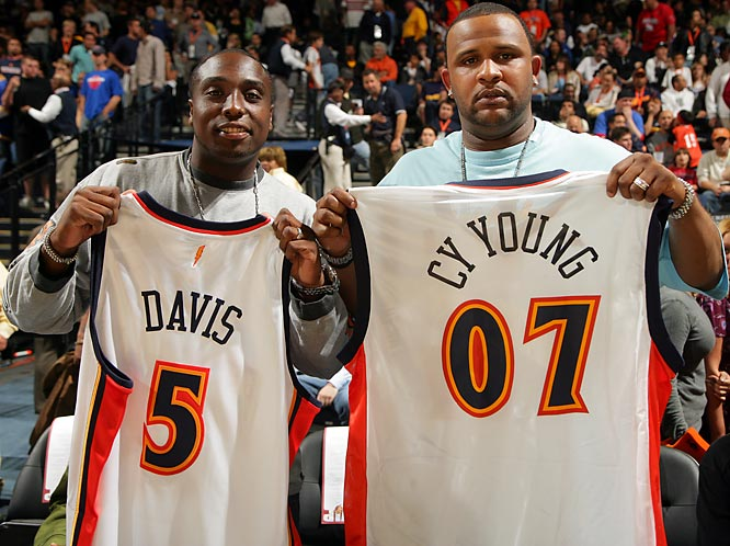 Dontrelle Willis (left) and Cy Young Winner C.C. Sabathia show off their Warriors jerseys during Golden State's game against the Pistons this past Wednesday.