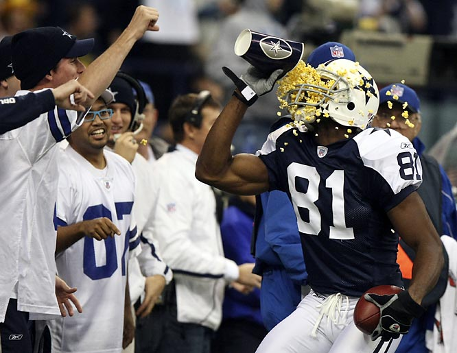 Terrell Owens, shown here after scoring a TD in Thursday's win against the Packers, never stops putting on a show for the fans.