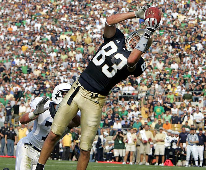 Although Notre Dame Stadium is one of the most difficult venues we work in -- because of all the people on the field, from the cheerleaders to the bands to the alumni and supporters -- it tends to lend itself to some interesting pictures. In this case, a Notre Dame TD catch in the middle of the end zone in front of a Penn State defender.<br><br>Shot with: Canon EOS-1D Mark II, EF 70-200mm f/2.8L IS USM zoom, shot at 1/1250 f/5.6