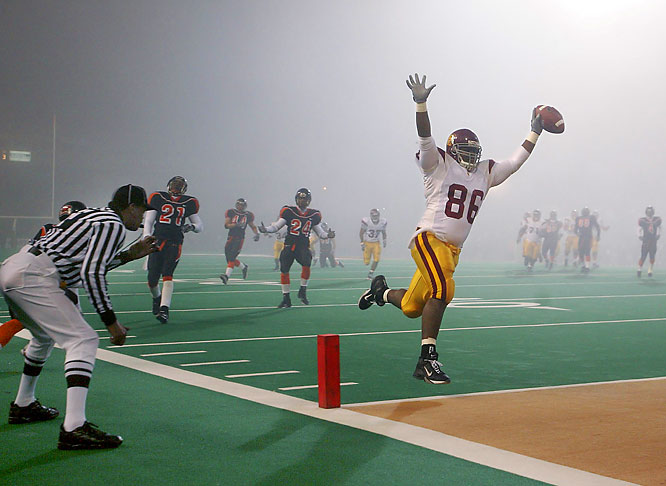 I walked out of the press box 20 minutes before this USC-Oregon State game and couldn't see the field through the fog. Using a wide angle lens, I was able to get this striking photo that caught the jubilation of the USC player, the despair of the OSU players behind him, and beyond that the mystical foggy quality.  Shot with: Canon EOS-1D Mark IIN, EF 16-35mm f/2.8L USM, shot at 1/640 f/2.8