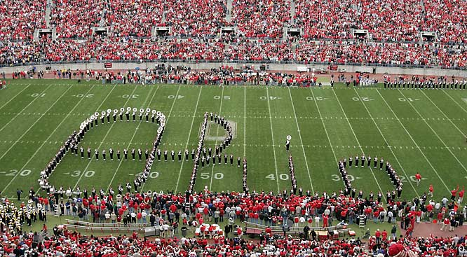 The Ohio State Buckeyes' marching band has been famously spelling out its home state since 1938, with the I dotted by a kick, turn, and bow by the sousaphone player. (The cheer-inspiring move was originally improvised by an early-arriving marcher who needed to synch up with the final note.)