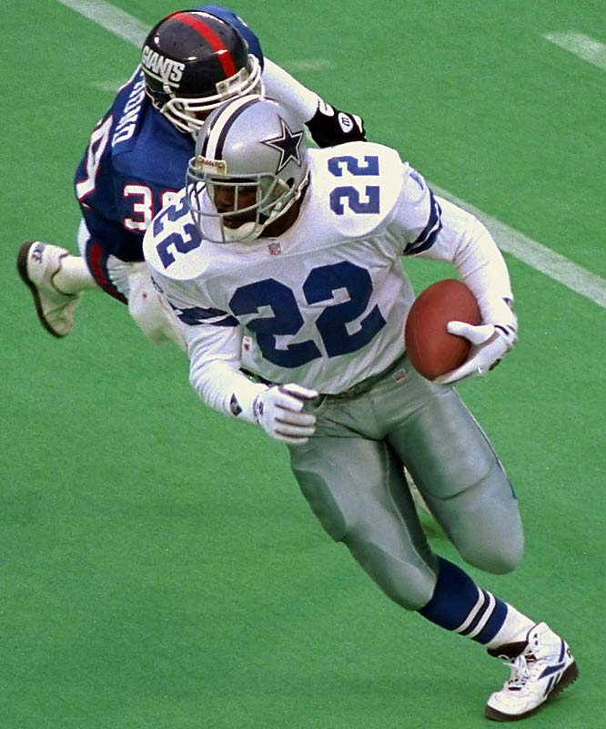 Two of the game's fiercest rivals met on the final day of the regular season with the NFC East title up for grabs. Playing in agonizing pain due to a first-degree separation of his right shoulder, Dallas running back Emmitt Smith rushed for 168 yards and touched the ball a franchise-record 42 times -- with 32 carries and 10 receptions. He produced 229 of his team's 339 yards in a 16-13 overtime victory. The Cowboys would go on to win a second consecutive Super Bowl.