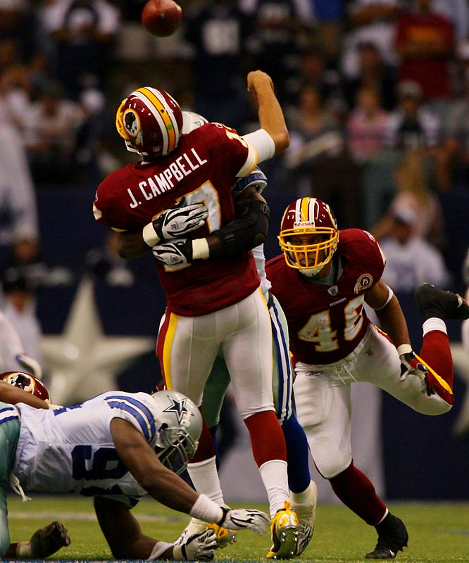 With their NFC East grudge match Sunday at Texas Stadium, the Cowboys and Redskins added the latest photo finish to a rivalry replete with them. Facing a 28-23 deficit in the last two minutes, Washington's Jason Campbell drove the visitors into the red zone for a potential go-ahead score -- but Terence Newman's interception with 1:39 remaining sealed the victory for the first-place `Boys.