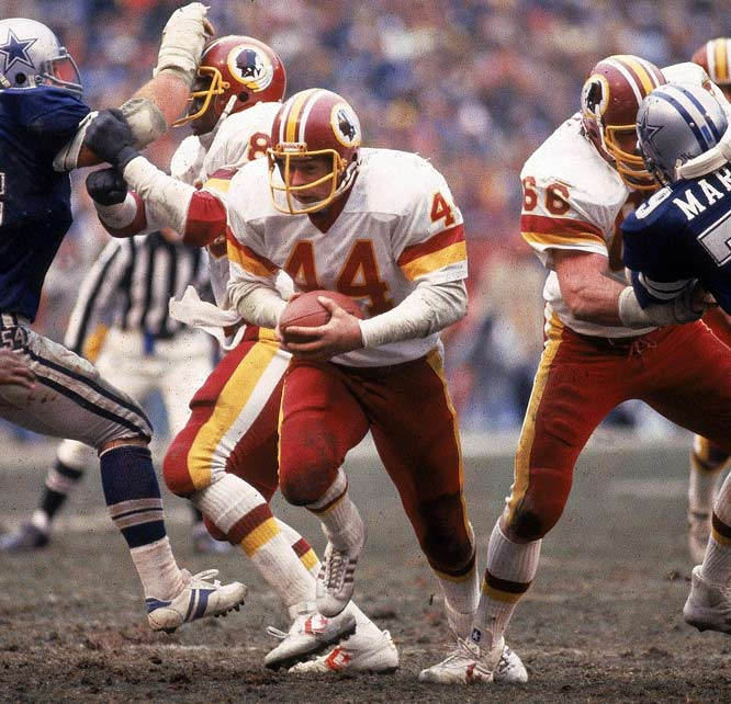 In finding the end zone 24 times during the regular season, John Riggins had established an NFL record that would stand for 12 years. In scoring two more touchdowns during his team's NFC title game clash with Dallas, Washington's workhorse back spirited his team into Super Bowl XVII -- where the Redskins would bring home their first NFL championship in 40 years.