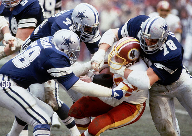"Just eight months following their NFC Championship Game disappointment, the Cowboys returned to RFK Stadium for the season opener on Monday Night Football. The hosts sprinted out to a 24-3 lead -- to the delight of 55,045 fans screaming ""We Want Dallas!"" -- but Danny White's second-half heroics sparked the Cowboys to a dramatic 31-30 victory."