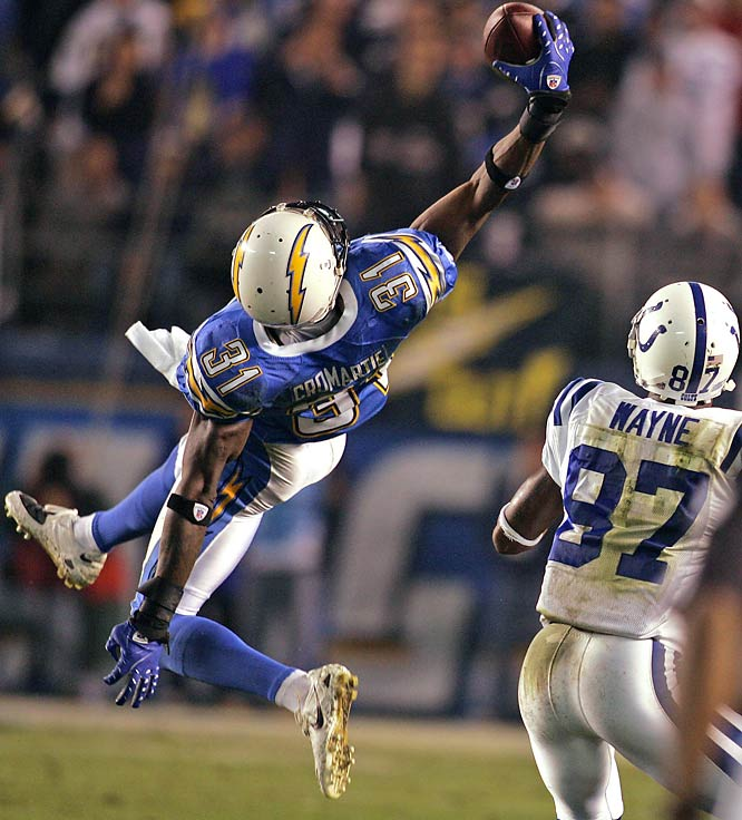 Cornerback Antonio Cromartie leaps in front of Colts' receiver Reggie Wayne to make his third interception of the game, just 36 seconds into the second quarter.  Cromartie was responsible for half of Peyton Manning's six interceptions in the game.