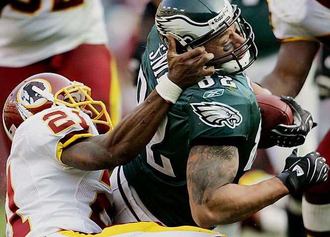 Redskins' safety Sean Taylor pulls down tight end L.J. smith in the third quarter.  Taylor was flagged for a face mask penalty of 15 yards on the play.