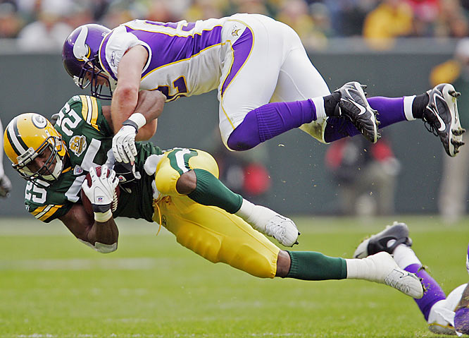 Vikings linebacker Chad Greenway makes a flying tackle on Packers running back Ryan Grant in the first half.  Grant rushed for a career-high 119 yards and a touchdown against the Vikings.