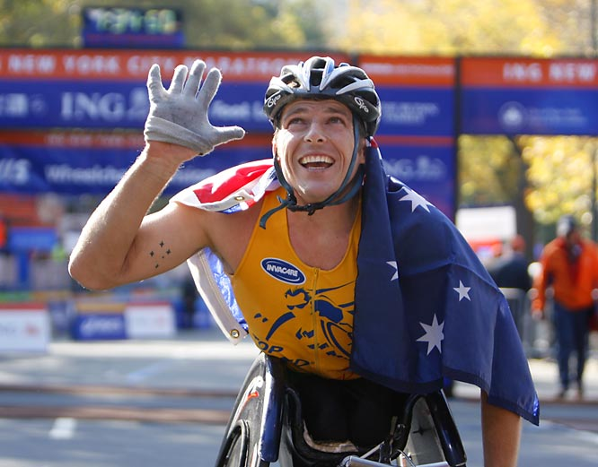Kurt Fearnley, winner of the men's wheelchair division, waves to marathon supporters in Central Park.