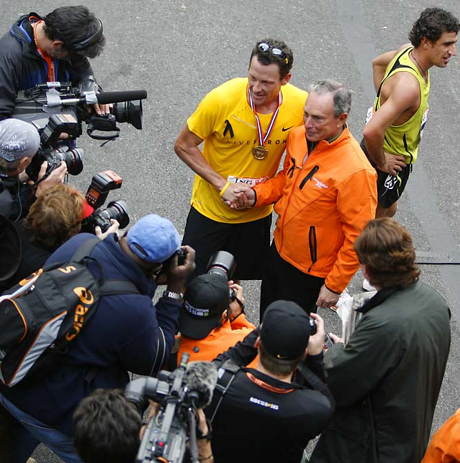 Lance Armstrong is congratulated by New York City Mayor Mike Bloomberg upon completing his second New York City marathon.