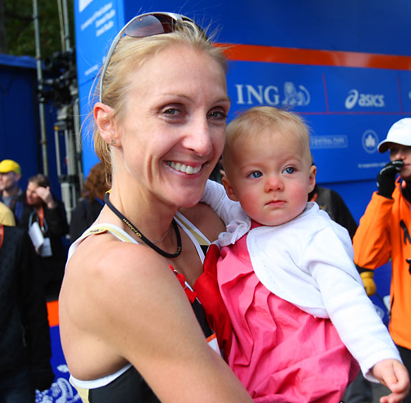 Paula Radcliffe enjoys her daughters company after placing first.