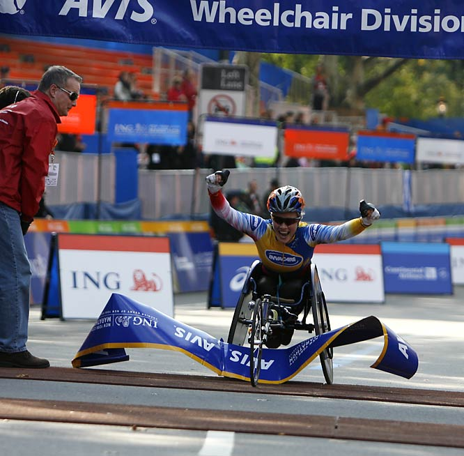 Edith Hunkeler, winner of the women's wheelchair division, was elated as she burst through the banner.