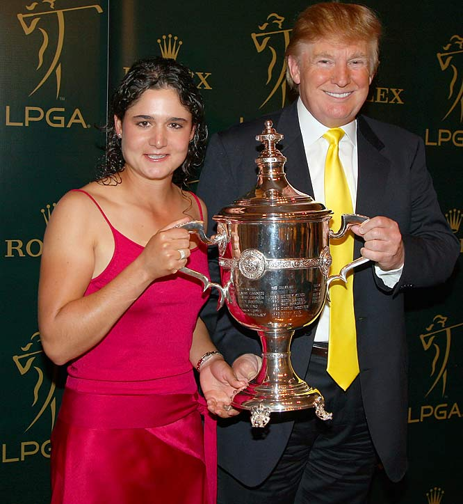 Donald Trump, for reasons unknown, holds the LPGA Rolex Player of the Year Award with its recipient, golfer Lorena Ochoa, who looks only slightly uncomfortable in doing so.