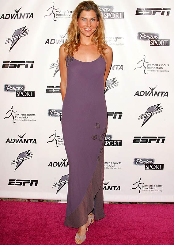 Dressed up in an evening gown and heels, tennis player Monica Seles looks almost unrecognizable on the pink carpet of the Women's Sports Foundation's 28th Annual Salute to Women in Sports.