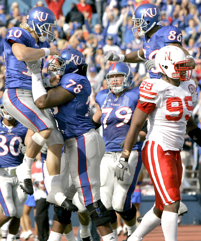 Kerry Meier (10) caught a touchdown pass, one of a Kansas-record six from Todd Reesing as the Jayhawks piled up the most points ever scored on the Huskers in the program's 117-year history.