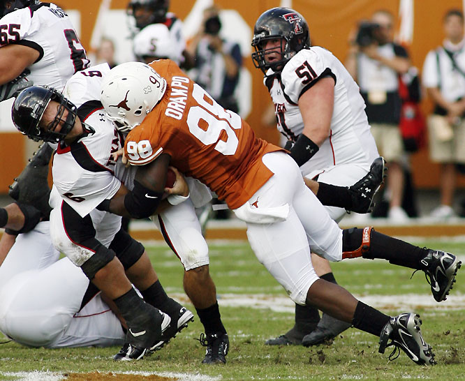 The Longhorns scored 24 fourth-quarter points to hold off the high-flying Red Raiders. Texas QB Colt McCoy passed for four touchdowns and ran for two more.
