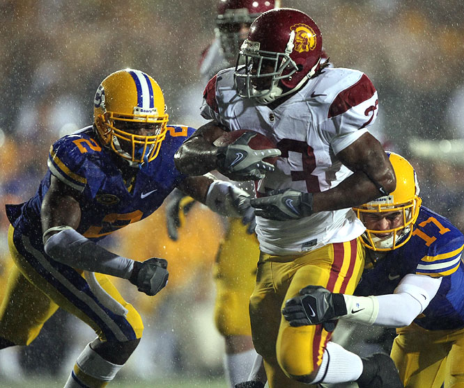 The Trojans stayed in the Rose Bowl hunt behind Chauncey Washington's career-high 220 rushing yards.