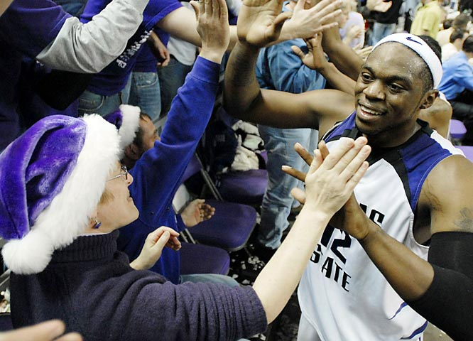 Kansas State forward Bill Walker celebrates with fans after beating Cal, 82-75.