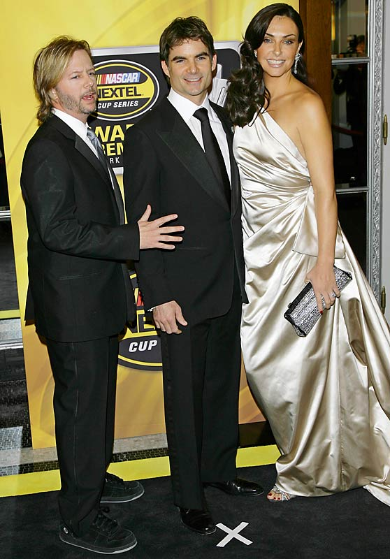 David Spade sticks out like a sore thumb in this photo with Jeff Gordon and his wife, Ingrid Vandebosch, at NASCAR's awards ceremony in New York.