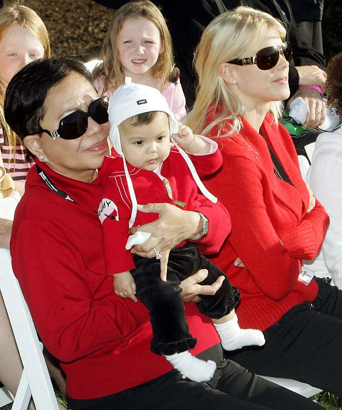 Tiger Woods' newest fan, daughter Sam Alexis, watches with her grandmother Kultida and mom, Elin, as daddy wins the Target World Challenge golf tournament.