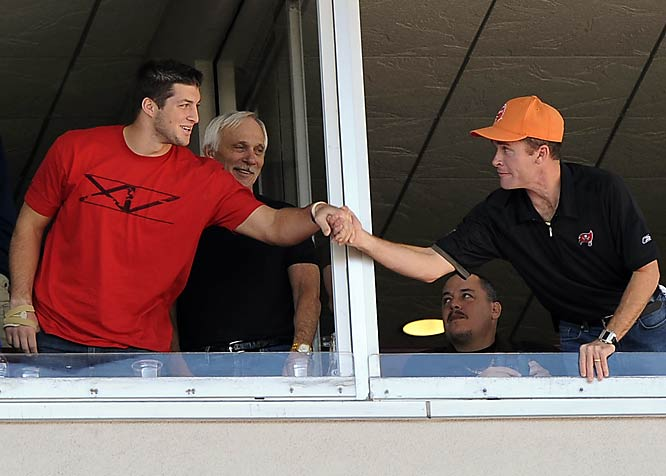 Heisman winner Tim Tebow (far left) took in last Sunday's Falcons-Bucs game and showed that he's not too big to mingle with the fans -- or at least the ones in luxury boxes.