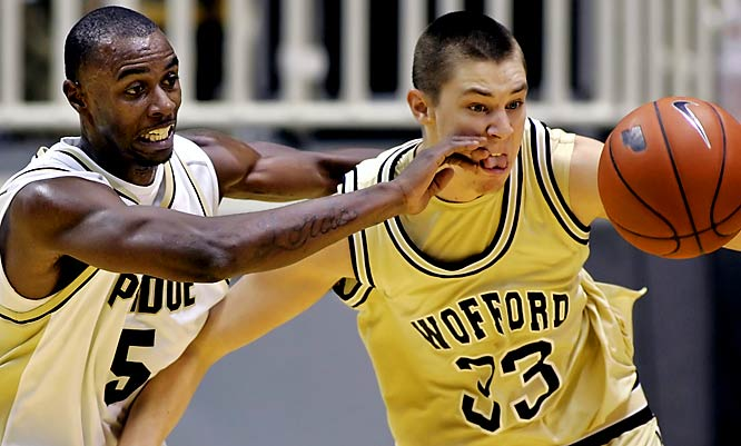 Purdue's Keaton Grant picks an odd time to stick his fingers in Corey Godzinski's mouth.