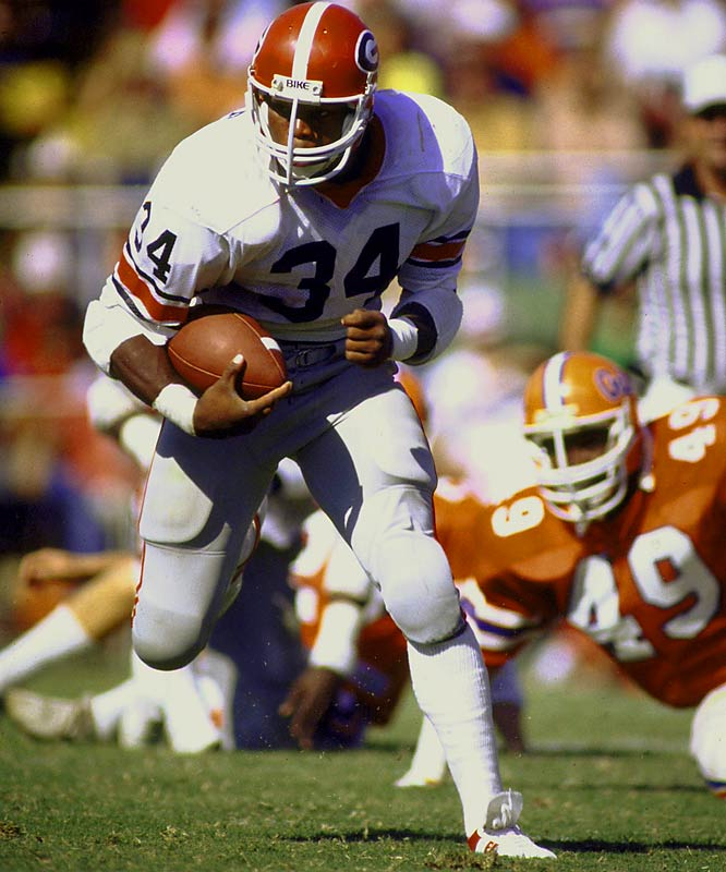 Walker rushed for 5,259 yards in three seasons and scored 55 touchdowns in 33 regular season games. In 1982 Walker became the seventh junior to win the Heisman Trophy, one place ahead of John Elway. He's on the short list for the greatest college football player ever.<br><br>Runner-up: <br>Bo Jackson, RB, Auburn (1982-85)<br><br>Send comments to siwriters@simail.com.
