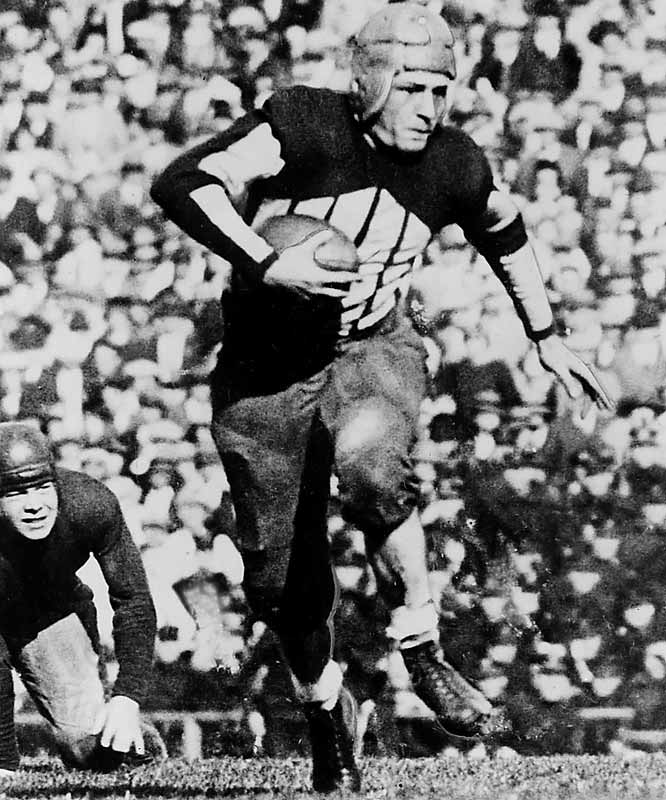 Nicknamed ''The Galloping Ghost'' for his elusiveness, Grange compiled mind-boggling statistics (20 games, 31 touchdowns and 3,362 yards) and marathon-like touchdown runs.<br><br>Runner-up: <br>Ron Yary, T, USC, (1965-67)