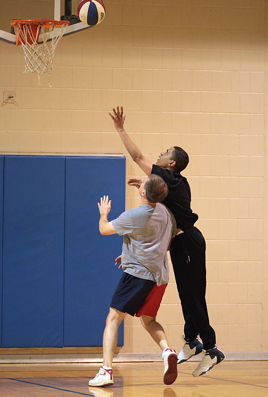 The Senator attempts a rebound. Price politely attempts to crack his ribs.