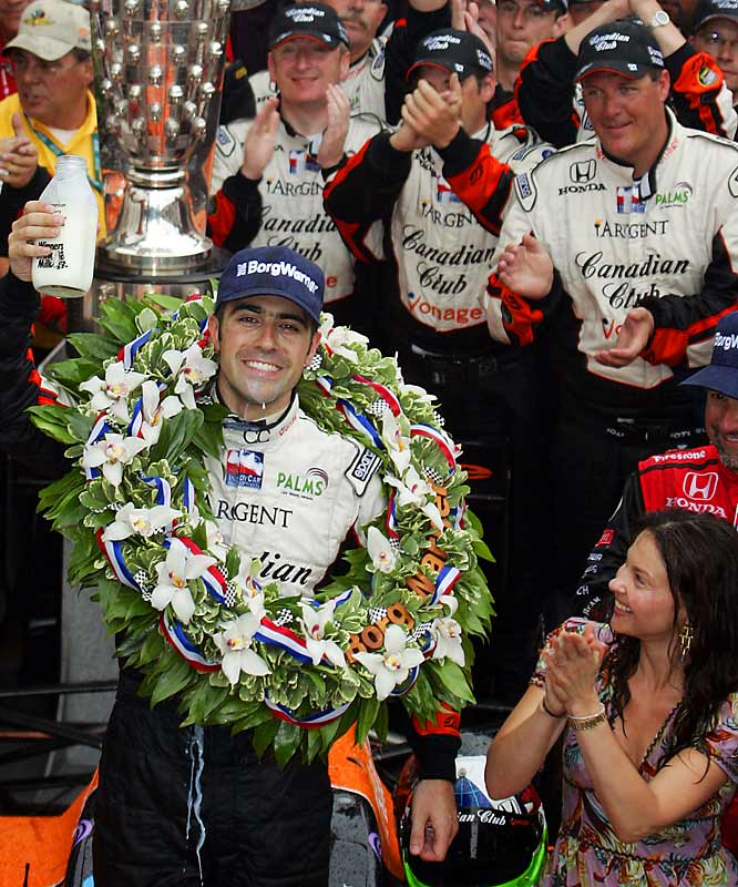With starlet wife Ashley Judd beaming in admiration, Dario Franchitti proved his meddle in the rain-plagued 500 at Indy.