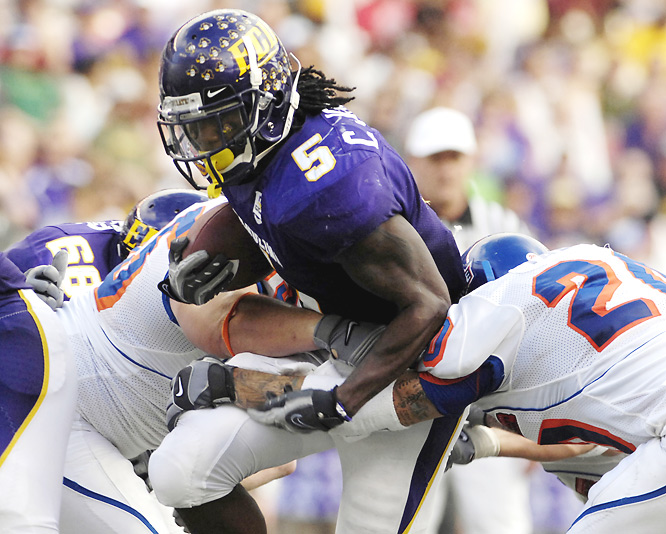 RB Chris Johnson (pictured) set an NCAA bowl record with 408 all-purpose yards and the Pirates upset last season's bowl darling, Boise State.