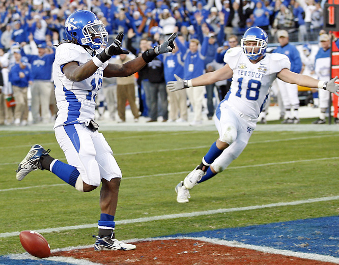 Andre Woodson finished a fabulous career at Kentucky by winning Music City Bowl MVP honors for the second straight year. Woodson threw for 358 yards and four touchdowns.