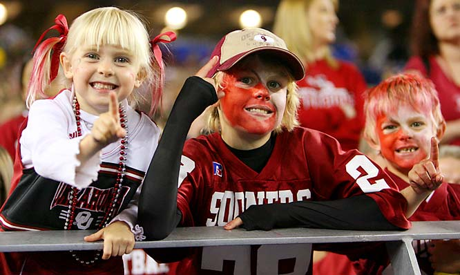 A Sooner mom and her children enjoy the early stages of Oklahoma's Fiesta Bowl matchup against West Virginia.