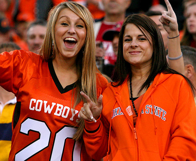 Oklahoma State fans enjoy a laugh before the second half of the Insight Bowl.
