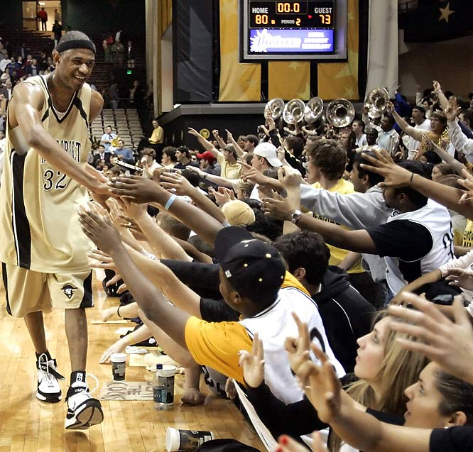 Vanderbilt's Shan Foster shakes hands with students after Vanderbilt's victory over South Carolina.