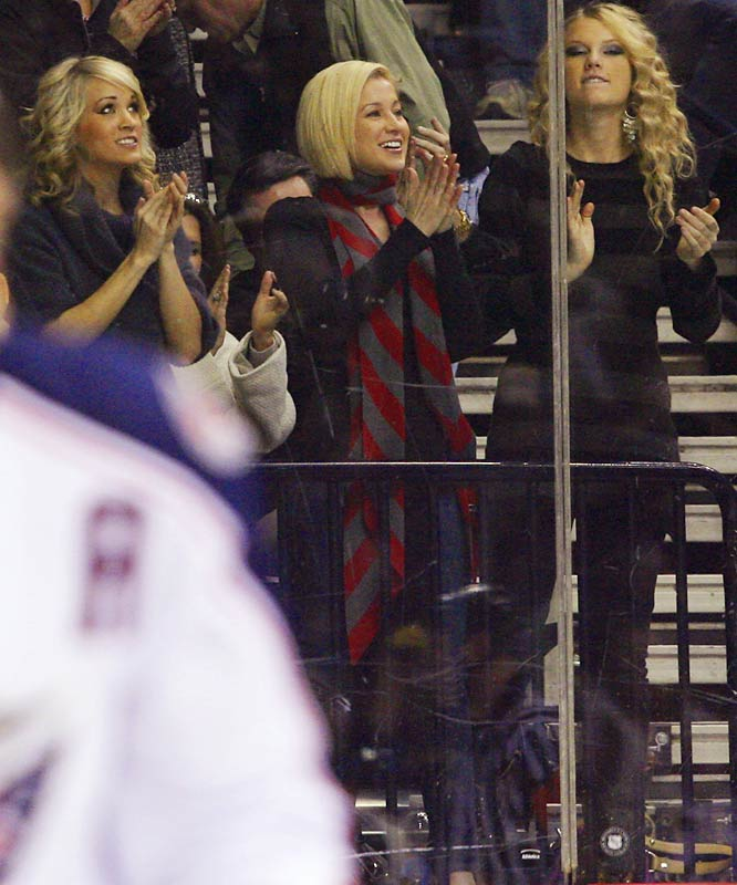 Country singers (left to right) Carrie Underwood, Kellie Pickler and Taylor Swift celebrate a goal by the Nashville Predators against Columbus on Dec. 27. If these are the kind of fans the Predators draw to their games, ticket sales must be through the roof.