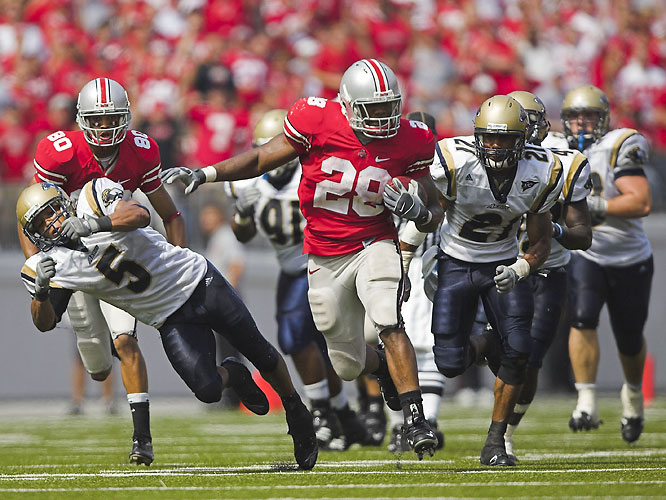 Ohio State only led 3-2 at the half, but the game was really never in question due to the Buckeyes' stifling defense. The Zips punted 14 times and managed just 71 total yards of offense. Beanie Wells (pictured) rumbled for 143 yards on 20 carries.