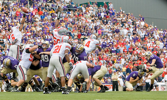 Washington held a 7-3 lead at the half, but the Buckeyes scored 24 points in the second half to put it away. Beanie Wells carried the ball 24 times for 135 yards and a touchdown, and Todd Boeckman threw two TD passes.