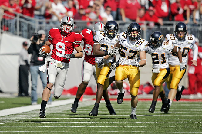 Ohio State scored 28 points in the second quarter, including Brian Hartline's 90-yard punt return touchdown (pictured) and Donald Washington's 70-yard score off an interception.