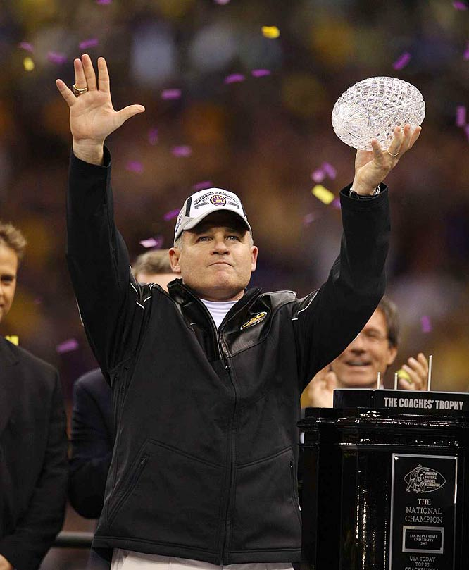 LSU coach Les Miles acknowledges the crowd while holding the national championship trophy. The Tigers finished the season 12-2 and are the first two-loss team to be crowned national champions.