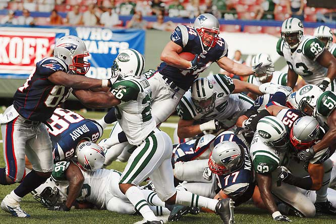 Heath Evans leaping over a pile of bodies for a touchdown against the Jets.